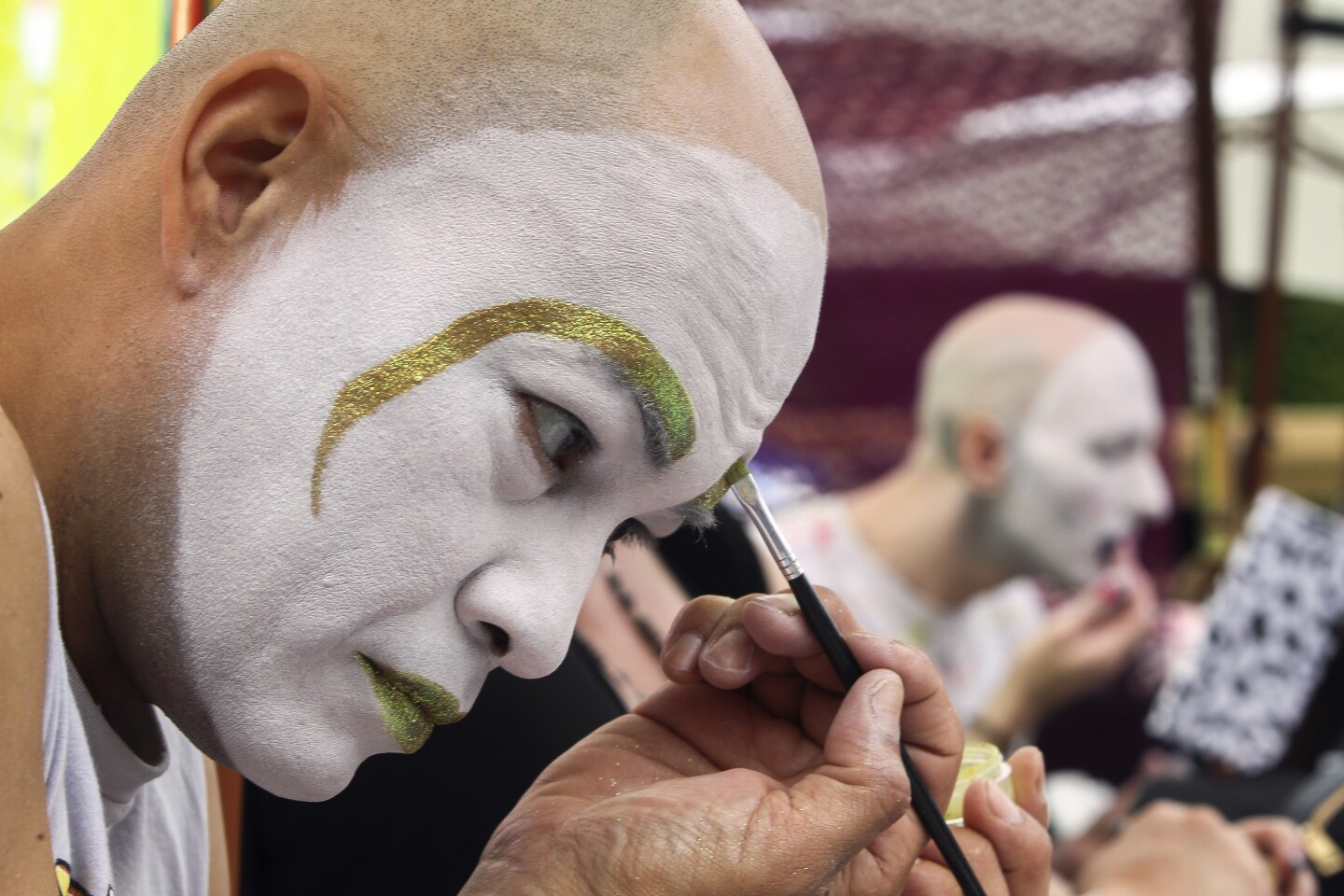 Sister Amanda Reckinwith and Novice Sister Lavinia Longthyme, background, who are both members of the San Diego Sisters of Perpetual Indulgence, put on makeup in preparation to bless a ribbon cutting ceremony during the Out at the Fair festival at the San Diego County Fair on Saturday, June 1, 2019 in Del Mar, California.