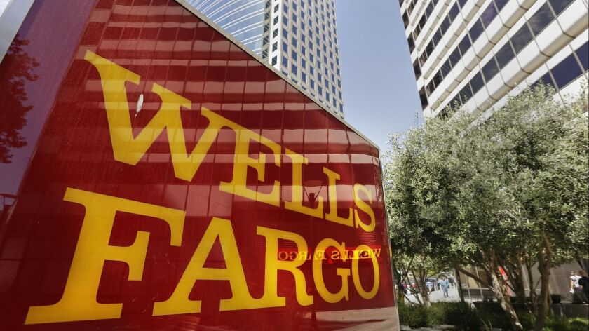 FILE - This July 14, 2014 file photo shows Wells Fargo offices in Oakland, Calif. The Wall Street