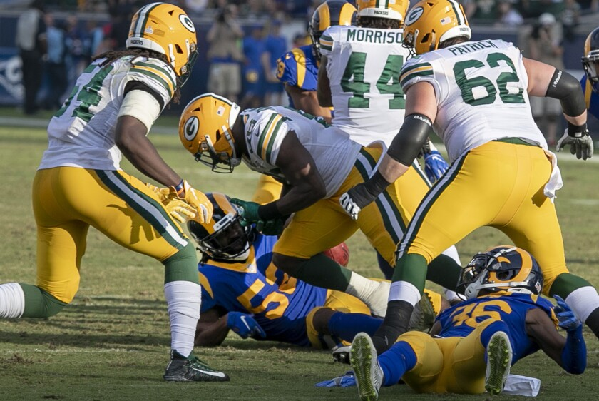 Packers kick returner Ty Montgomery (88) has the ball stripped from him by Rams linebacker Ramik Wilson, who recoverd the fumble, late in the fourth quarter.