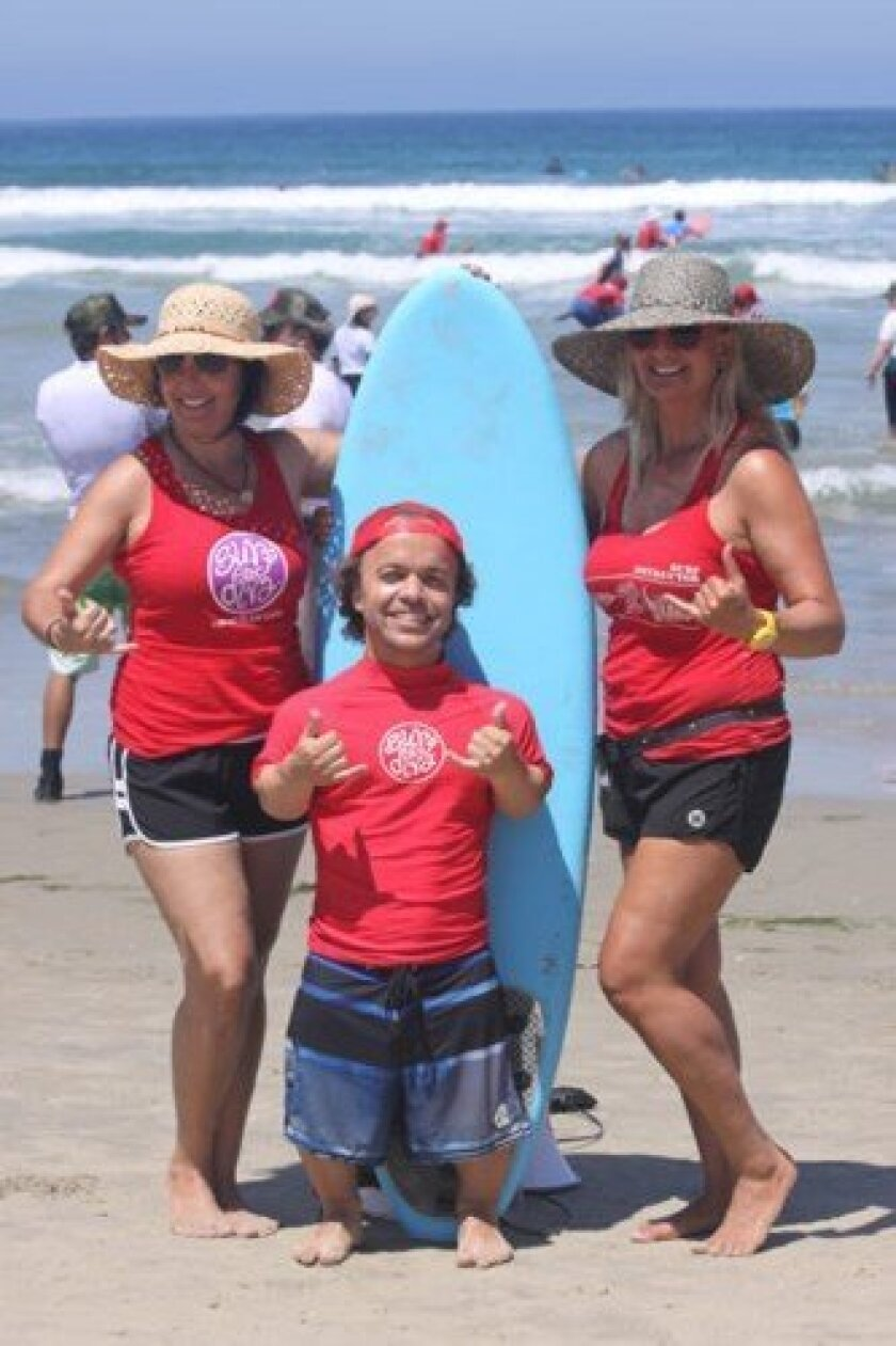 Event coordinator Ryan Gambrell with Surf Diva owners Coco and Izzy Tihanyi.