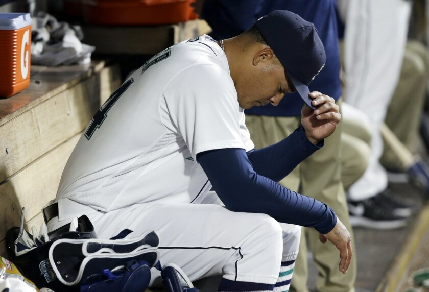 Seattle Mariners starting pitcher Taijuan Walker sits in the dugout after he was pulled from a baseball game against the Oakland Athletics in the eighth inning of a baseball game Monday, May 23, 2016, in Seattle. (AP Photo/Ted S. Warren)