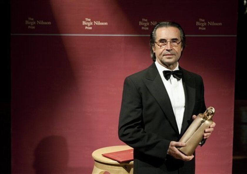 Italian maestro conductor Riccardo Muti of the Chicago Symphony Orchestra holds his trophy after receiving the Birgit Nilsson Prize during the Birgit Nilsson Prize award ceremony at the Royal Opera in Stockholm, Sweden, on Thurday Oct. 13, 2011. The Birgit Nilsson prize is awarded for outstanding achievement in opera and concert to active classical musicians. (AP Photo/Scanpix Sweden/Pontus Lundahl)