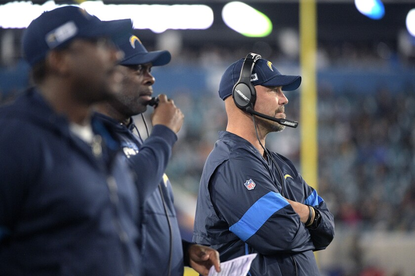 Chargers defensive coordinator Gus Bradley and coach Anthony Lynn look on from the sideline.