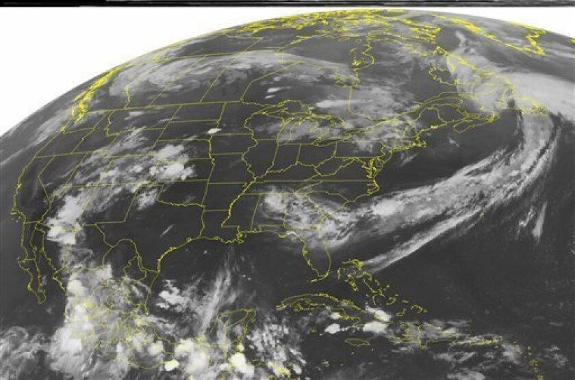 This NOAA satellite image taken Sunday, July 10, 2011 at 1:45 a.m. EDT shows clouds over parts of the Southeast and Northeast, overwise much of the rest of the country is under slear skies. (AP PHOTO/WEATHER UNDERGROUND)