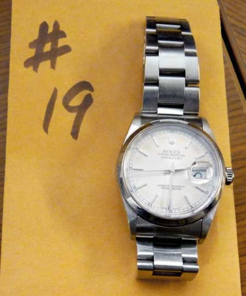 Photos of recovered property linked to a crime wave tied to South L.A. gang members. PIctured, a Rolex watch.
