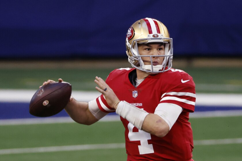 FILE - San Francisco 49ers quarterback Nick Mullens (4) looks to throw against the Dallas Cowboys during an NFL football game in Arlington, Texas, in this Sunday, Dec. 20, 2020, file photo. The Philadelphia Eagles agreed to terms with quarterback Nick Mullens on Monday, June 14, 2021. The 26-year-old Mullens spent his first four seasons with the San Francisco 49ers, going 5-11 in 16 starts. (AP Photo/Ron Jenkins, File)