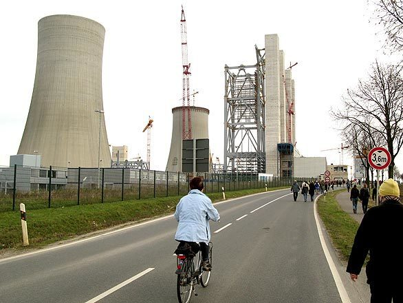 Massive towers dominate a power plant under construction in Neurath, Germany, near Grevenbroich, a town that downplays its reputation as the carbon emissions capital of Europe by reminding visitors, with signs around town, that it is also Germany's energy capital.