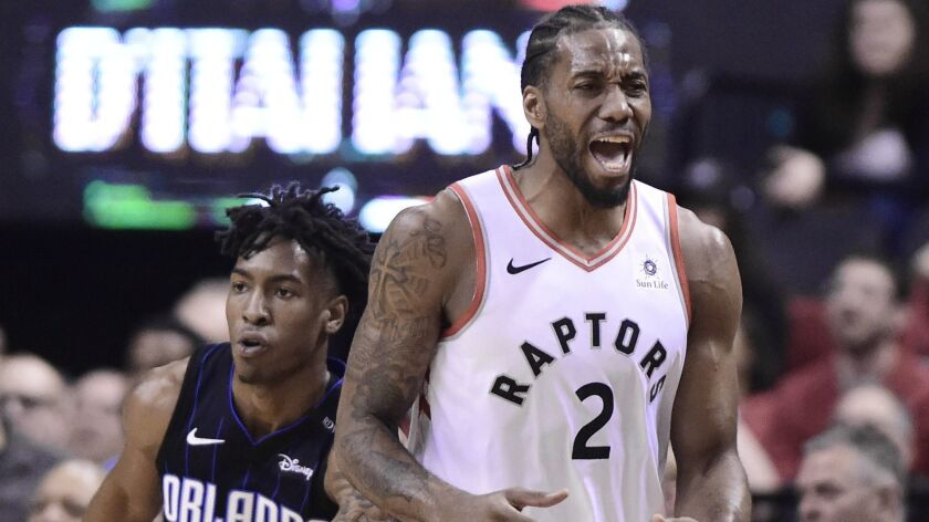 Toronto Raptors forward Kawhi Leonard (2) heads up court during the first half in Game 5 of a first-