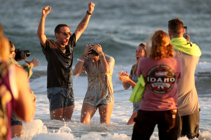 A worshiper is baptized at a Saturate O.C. event in Huntington Beach
