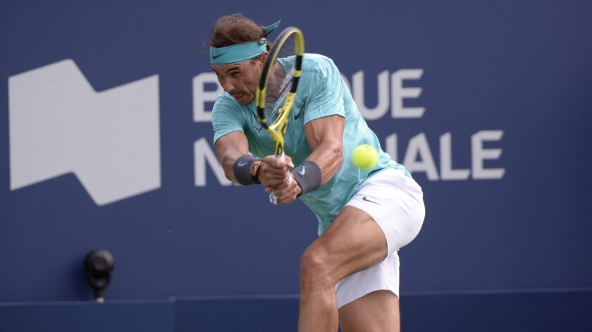 Rafael Nadal hits a return against Daniil Medvedev during the Rogers Cup final in Montreal on Aug. 11.