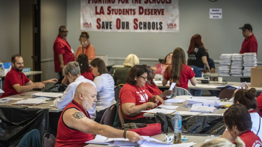 United Teachers Los Angeles volunteers prepare ballots to be counted which will decide whether to au