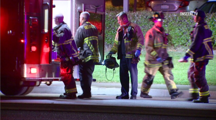 Oceanside firefighters and paramedics load an injured woman into an ambulance Friday night after she was struck by a Toyota Camry on Mission Avenue near El Camino Real.