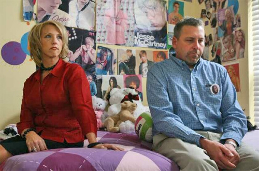 GRIEVING: Tina and Ron Meier sit in daughter Megan's bedroom in a suburb of St. Louis. Megan killed herself last fall.