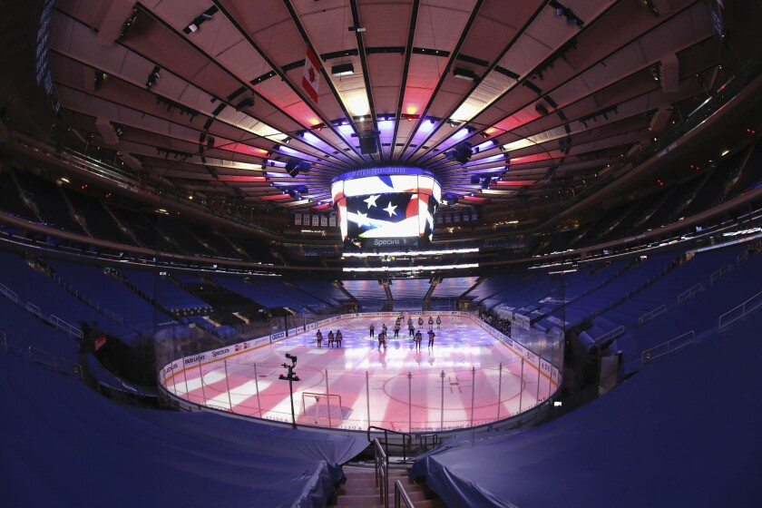 The New York Rangers prepare to play against the Boston Bruins in an NHL hockey game Wednesday, Feb. 10, 2021, in New York. (Bruce Bennett/Pool Photo via AP)