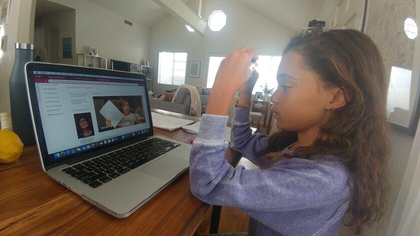 Parker Curry does her homework online