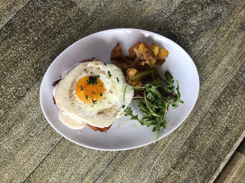 Lo Croque, a new take on the Croque Monsieur breakfast sandwich at Urban Solace in North Park, which has transformed from a full-service restaurant into a breakfast eatery and nighttime hotspot with small plates menu.