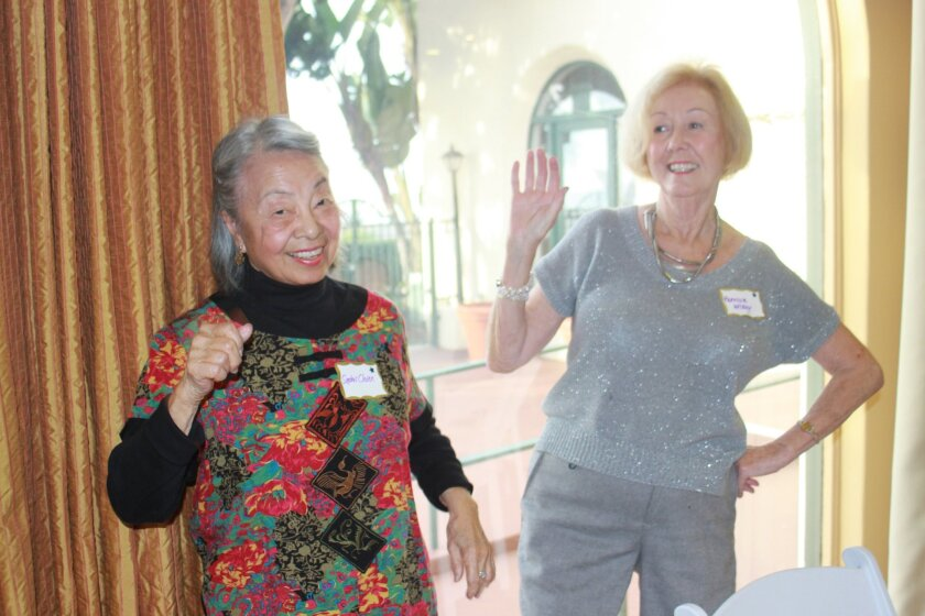 Sophie Chien and Patricia Wilkey dance at the Casa de Manana 90th anniversary party.