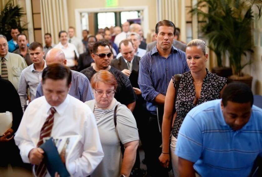After the government reported last week that the economy added just 96,000 jobs in August, economists polled by Reuters said there was a 60% chance the Fed would launch another round of bond buying. Above, job seekers wait at a job fair last week in San Diego.