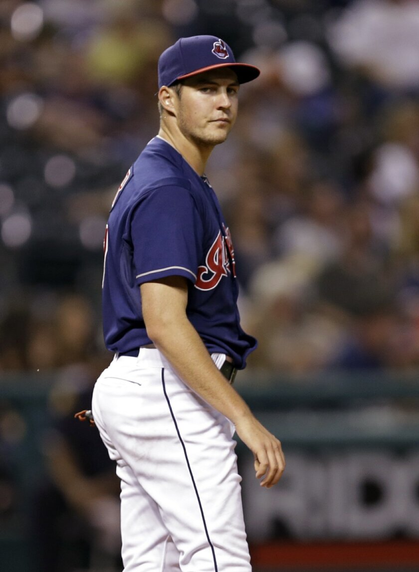 Cleveland Indians starting pitcher Trevor Bauer watches Minnesota Twins' Oswaldo Arcia round the bases after a two-run home run in the fourth inning of a baseball game Tuesday, Sept. 9, 2014, in Cleveland. (AP Photo/Mark Duncan)