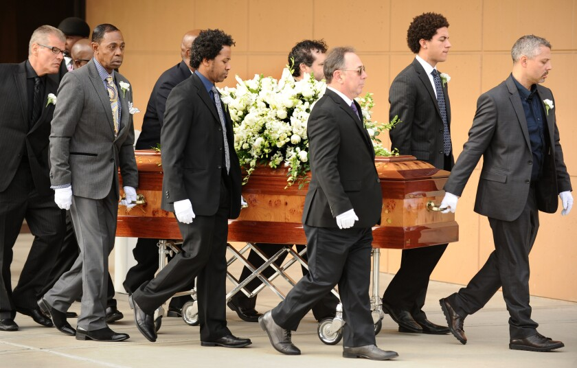The casket of singer Natalie Cole is carried out of the West Angeles Church of God in Christ during funeral services Monday.