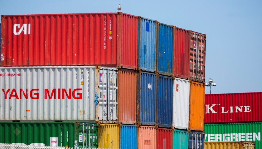 Shipping containers sit on the docks at the Conley Shipping Terminal in Boston, Massachusetts, on July 10.