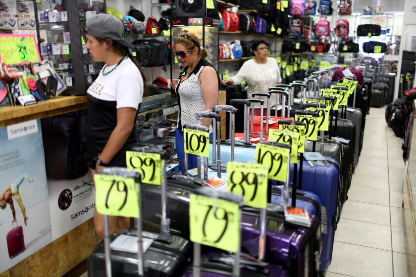 Shoppers browse in a store on April 14 in Miami.