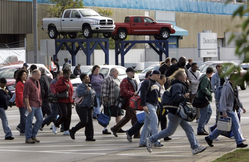 Workers leave a Chrysler factory in Warren, Mich., in 2007.