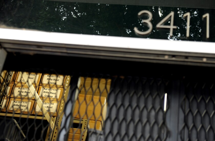 Boxes of supplies can be seen through a grate at one of the Botach Tactical warehouses in Leimert Park in Los Angeles.