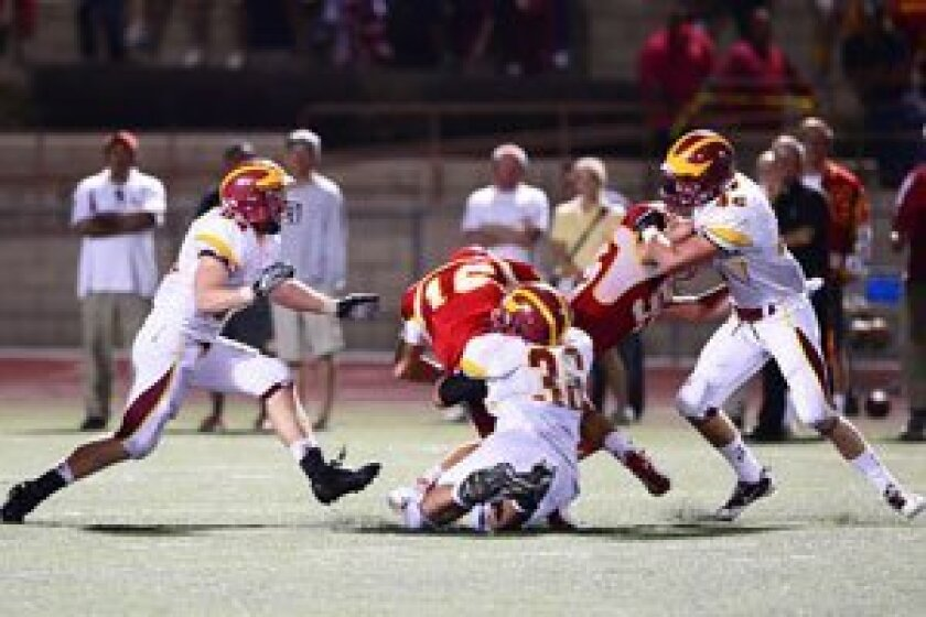 Torrey Pines Defensive Tackle Grant McGahey (#36, shown here sacking Cathedral Catholic's Garrett Bogart) was selected by Palomar League Football Coaches to the All-League First Team. McGahey led Torrey Pines in tackle points, sacks and tackles-for-a-loss. Sean Haratyk (#84) and Jonathan Raby (#42) are also shown closing in during the Falcon's Sept. 7, 2012 victory over the Dons. Photo/Anna Scipione