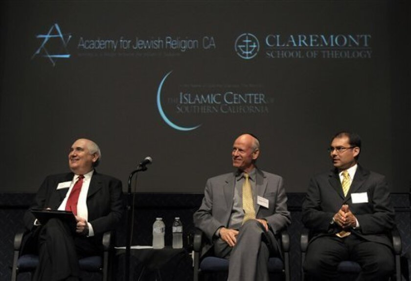 Rev. Jerry Campbell, Rabbi Mel Gottlieb, and Imam Jihad Turk, from left, listen at a press conference at Claremont School of Theology announcing the launch of the University Project, which will integrate the education of ministers, rabbis and Muslim religious leaders, on Wednesday, June 9, 2010, in Claremont, Calif. (AP Photo/Adam Lau)