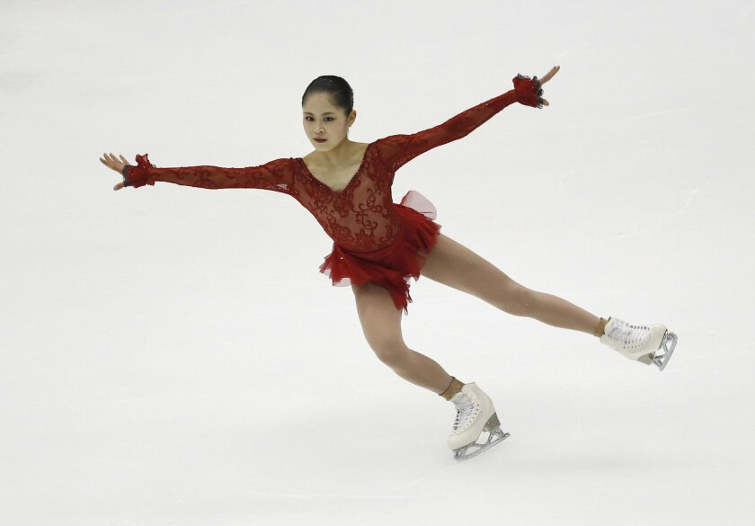 Satoko Miyahara of Japan performs during the Ladies Short Program of the Taiwan ISU Four Continents Figure Skating Championships in Taipei, Taiwan, Thursday, Feb. 18, 2016. Miyahara finished first. (AP Photo/Wally Santana)