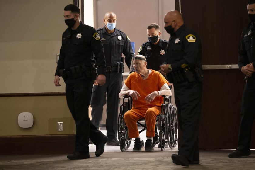 Deputies use a wheelchair to bring Joseph James DeAngelo into the courtroom