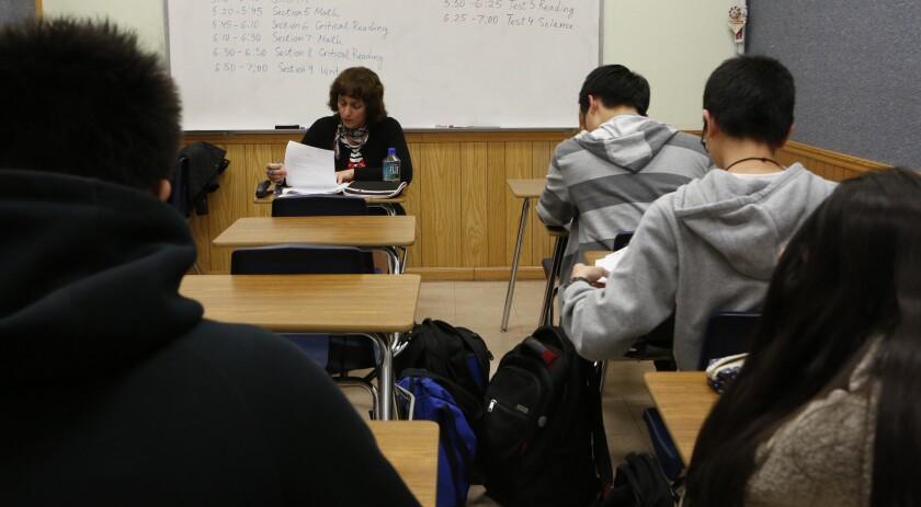 Teacher Svetlana Djananova supervises students taking an ACT college admission exam at HS2 Academy in Arcadia in February.