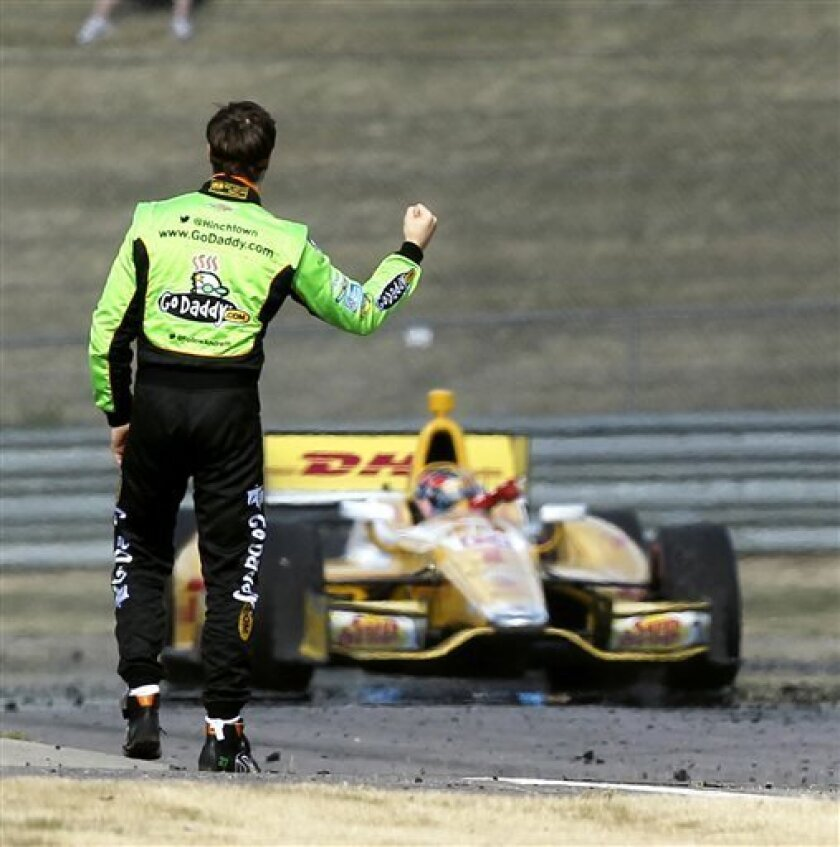 James Hinchcliffe, left, gives a fist pump to teammate Ryan Hunter-Reay after Hunter-Reay won the IndyCar Series Grand Prix of Alabama auto race in Birmingham, Ala., Sunday, April 7, 2013. (AP Photo/Butch Dill)