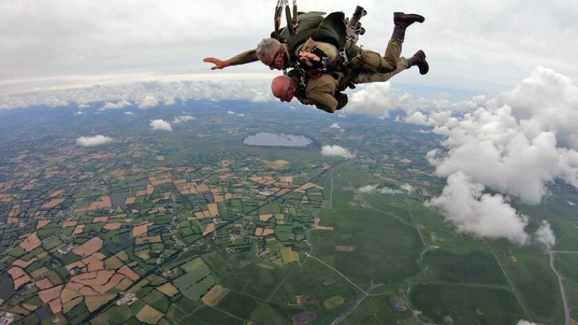 D-Day veteran Tom Rice, of Coronado, in tandem jump with Art Shaffer, top, over Normandy, France in 2019.