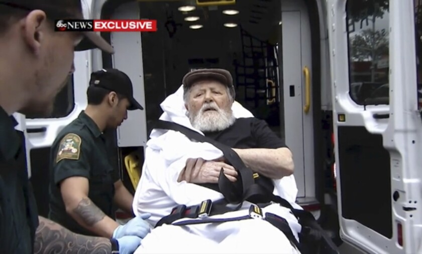 Jakiw Palij, a former Nazi concentration camp guard, is carried on a stretcher from his home into a waiting ambulance in the Queens borough of New York on Aug. 20, 2018.