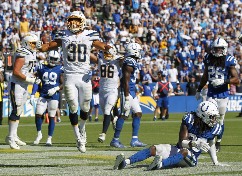 Chargers running back Austin Ekeler (30) celebrates his game-winning touchdown in overtime against the Indianapolis Colts on Sunday in Carson.