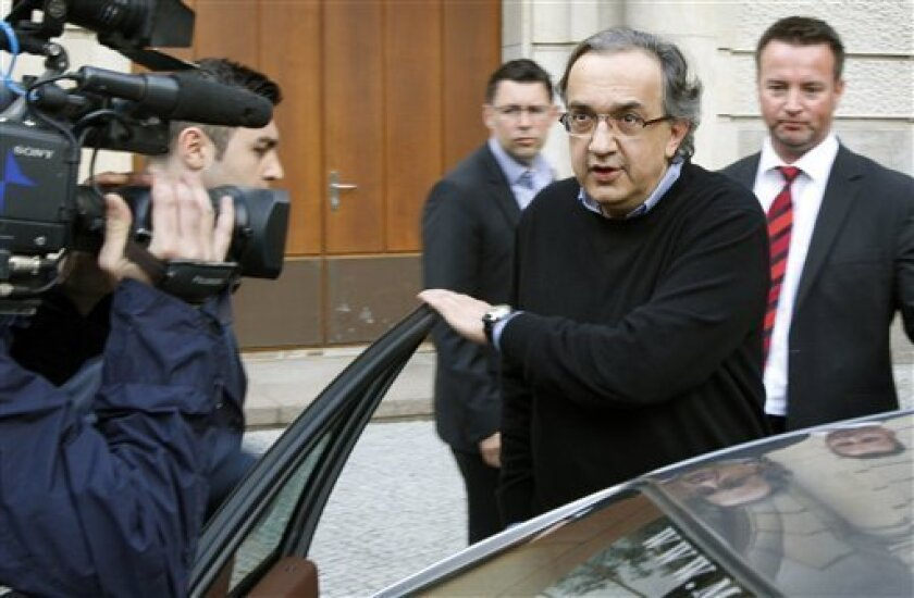 Sergio Marchionne, Manager of Italian Fiat car company, leaves after a meeting with German Economy Minister Karl-Theodor zu Guttenberg in Berlin, Monday, May 4, 2009. (AP Photo/Michael Sohn)