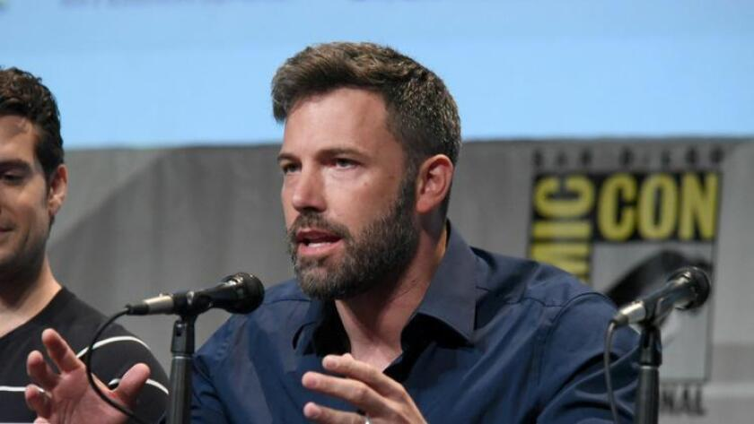 """Ben Affleck attends the """"Batman v Superman: Dawn of Justice"""" panel on Day 3 of Comic-Con International, on Saturday, July 11, 2015, in San Diego. (Richard Shotwell / Richard Shotwell/Invision/AP)"""