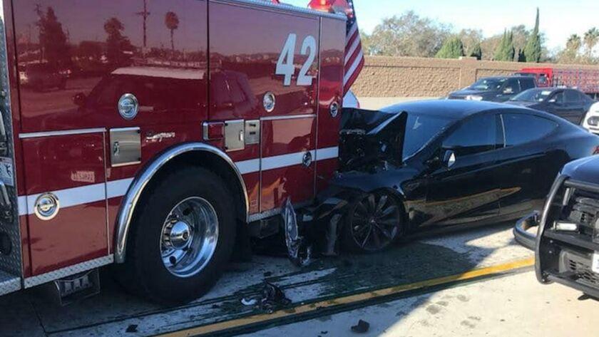 Tesla car hits firetruck on 405 Freeway