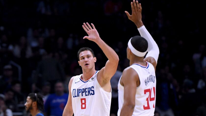 Clippers forwards Danilo Gallinari (8) and Tobias Harris combined to make six of 13 shots from three-point range during a 120-109 victory over Minnesota on Monday night.