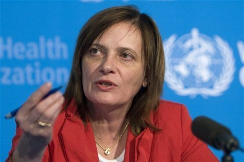"""French Marie-Paule Kieny, Director of the Initiative for Vaccine Research of the World Health Oorganisation (WHO), informs the media about the H1N1 Flu during a new global press conference at the World Health Organisation (WHO) headquarters in Geneva, Switzerland, Friday, May 1, 2009. The WHO said on Friday that tests had shown the current seasonal vaccine against flu would have little effect against the new H1N1 strain. """"There is very little chance that the seasonal vaccine ... will be effective against this particular virus,"""" Marie-Paule Kieny, director of the WHO's initiative for vaccine research, told a news conference. (AP Photo/Keystone, Salvatore Di Nolfi)"""