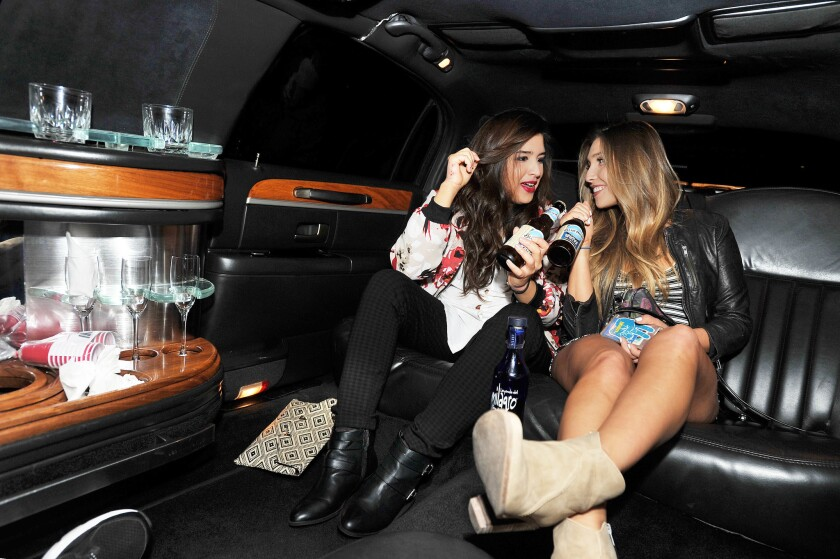 Bekah (left) and Jennie Nelson enjoy Blue Moon beer during Epic Limo ride on their PACIFIC blind date. (Rick Nocon)