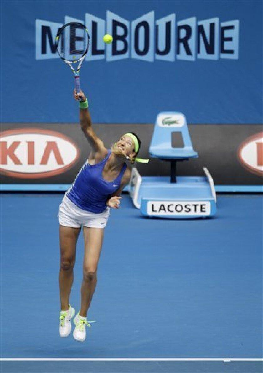 Victoria Azarenka of Belarus serves to Germany's Mona Barthel during their third round match at the Australian Open tennis championship, in Melbourne, Australia, Friday, Jan. 20, 2012. (AP Photo/Sarah Ivey)