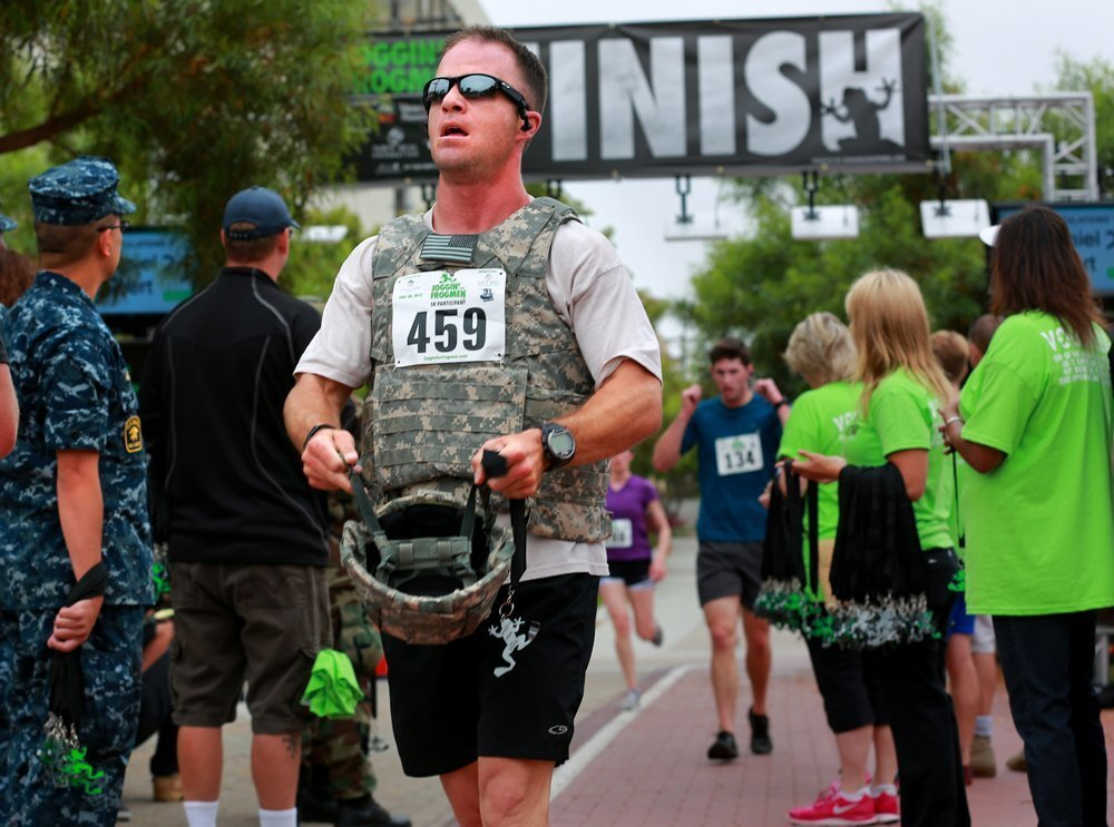 Matt Roth takes off his helmet after running the Joggin for Frogmen 5K in combat gear Sunday. Roth also participated in the recent San Diego Triathlon.