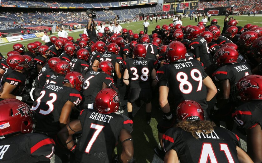 The Aztecs get revved up for September's home opener against Army at Qualcomm Stadium. San Diego State football, which was to play in the Big East, will remain in the Mountain West. Earnie Grafton • U-T
