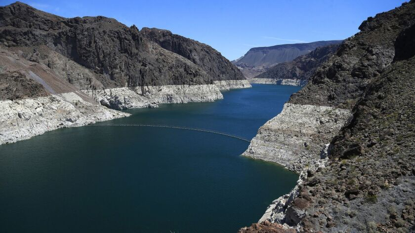 FILE - This May 31, 2018 file photo shows the reduced water level of Lake Mead behind Hoover Dam in