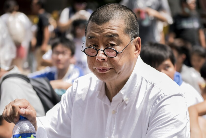 Hong Kong arrests pro-democracy media tycoon and opposition lawmakers