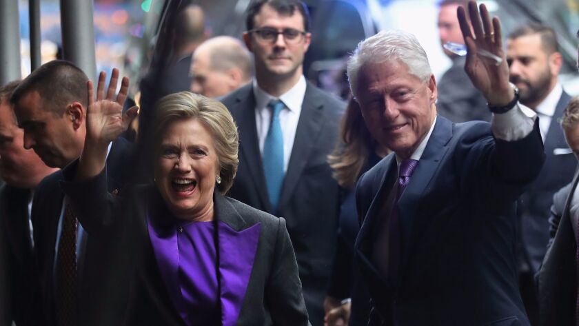 Hillary and Bill Clinton picked purple - a symbol of unity - for the Democratic candidate's concession speech on Nov. 9.