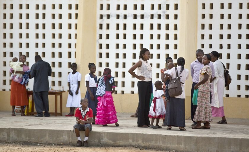 Christians gather outside prior to the service at the Our Lady of Consolation Church, which was attacked with grenades by militants almost three years ago, in Garissa, Kenya Sunday, April 5, 2015. Easter Sunday's ceremony was laden with emotion for the several hundred members of Garissa's Christian minority, which is fearful following the recent attack on Garissa University College by al-Shabab, a Somalia-based Islamic extremist group, who singled out Christians for killing, though al-Shabab has a long record of killing Muslims over the years. (AP Photo/Ben Curtis)